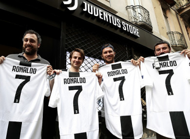 Juve fans buying jerseys with their new signing on the back in Turin.