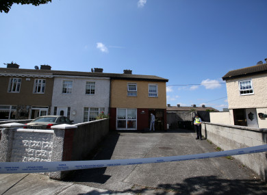Gardaí at the house where the man was found on Friday evening.