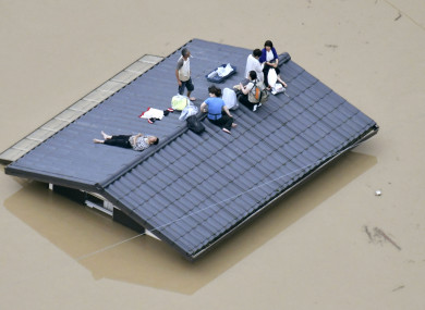 People waiting to be rescued in Okayama, Japan.