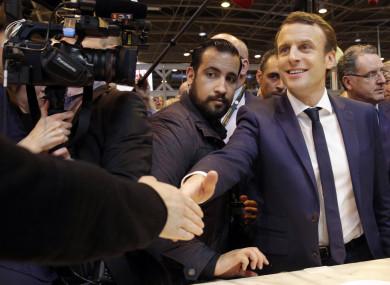 Emmanuel Macron, centre, flanked by his bodyguard, Alexandre Benalla, left.