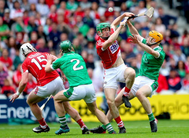 Cork and Limerick players battling for possession during the teams clash in June.