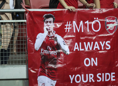 Arsenal fans show their support for Mesut Ozil during the International Champions Cup match between Arsenal and Atletico Madrid.