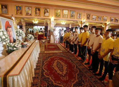 Members of the rescued soccer team pay their respect to Saman Gunan, who died during their rescue attempt.