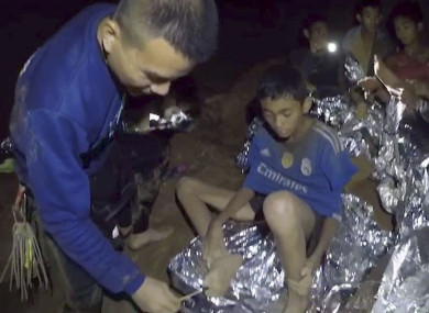 A doctor checks a boy's injury in the cave in Chiang Rai, Thailand.