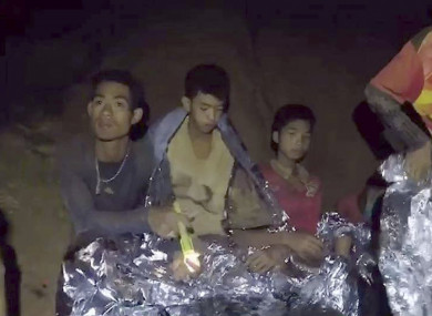 Trapped young footballers are seen in the cave in Chiang Rai.