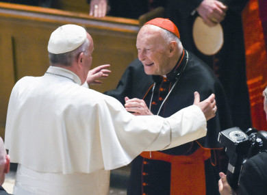 Pope Francis reaches out to hug Cardinal Archbishop emeritus Theodore McCarrick in 2015.