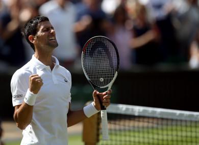 Novak Djokovic celebrates his win against Kei Nishikori on day nine of the Wimbledon Championship.