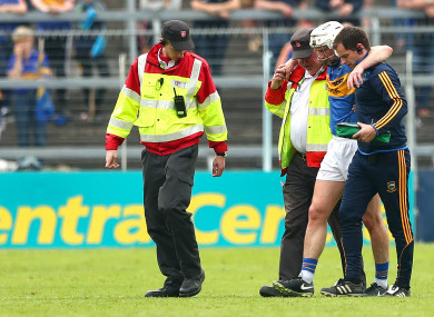 Brendan Maher is helped off my Tipperary medics after their loss to Clare.