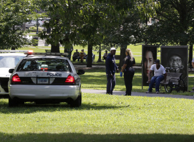 A police officer speaks to a man walking on New Haven Green, Connecticut