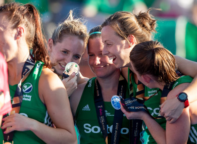 Members of the Irish women's hockey team celebrate with their silver medals following the World Cup earlier this month