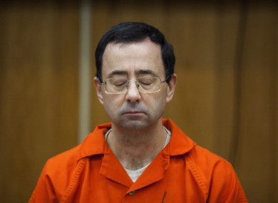 Larry Nassar listens during his sentencing in February.