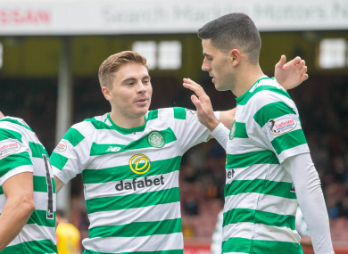 Celtic's Tom Rogic (right) celebrates scoring his side's third goal of the game.