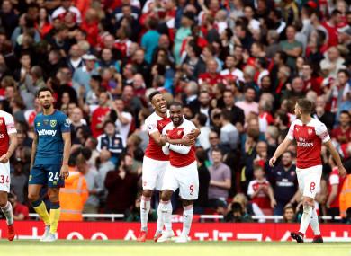 Alexandre Lacazette celebrates scoring Arsenal's third goal.