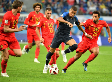 France striker Kylian Mbappe surrounded by Belgian players during the World Cup semi-final.