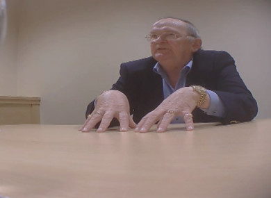 Hugh McElvaney being secretly filmed as part of an RTÉ Investigates broadcast in 2015.