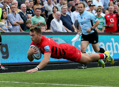 Alex Lewington goes over for a Saracens try.