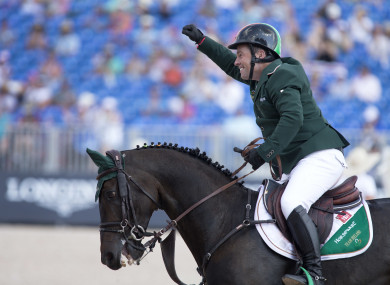 Cian O'Connor, aboard Good Luck, celebrates a clear round in the team and individual jumping championships,