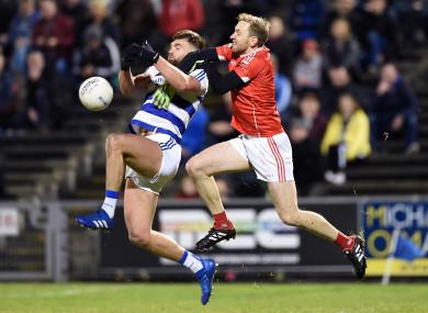 Aidan O'Shea contests a high ball with Cathal Hallinan.