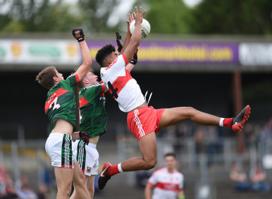 Derry's Callum Brown with Mayo's Brian O'Malley and John Cunnane during the U20 All-Ireland semi-final this summer.
