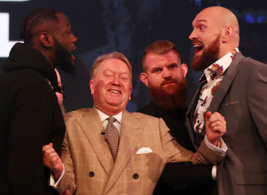 Fury and Wilder with promoter Frank Warren separating them.