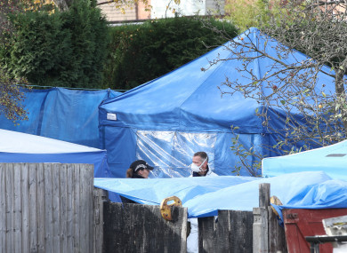 Police forensics tents in a back garden in Sutton Coldfield