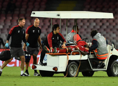 Keita is stretchered off the pitch.