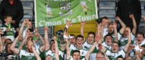 Portlaoise's Paul Cahillane and David Holland raise the trophy at the end of the game.