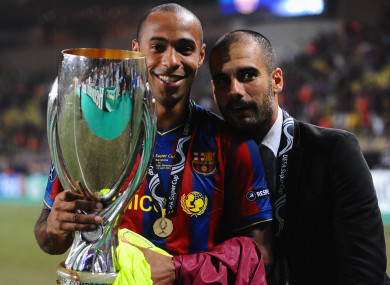 Thierry Henry holds the Uefa Super Cup alongside Pep Guardiola in August 2009.