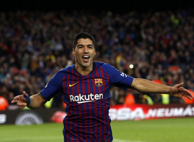 Luis Suarez celebrates the second goal on Sunday.