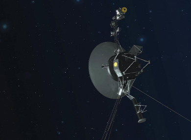 An artist's concept of the NASA Voyager 1 spacecraft with its antenna pointing towards Earth