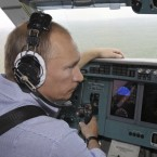 Putin sits in the co-pilot's seat among the crew of a firefighting airplane in early August, and helps put out two of the hundreds of wildfires that swept western Russia for weeks this summer.(AP Photo/RIA Novosti, Alexei Nikolsky, Pool)<span class=