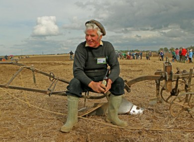 Gerard King rests with a much-deserved bottle of Guinness after finishing ploughing