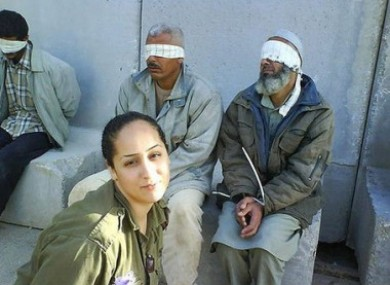 Ex-IDF soldier Eden Abergil posing with Palestinian prisoners.