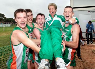 The Irish Men's U23 team of, David Rooney, Michael Mulhare, Brendan O'Neill and David McCarthy celebrate winning gold with coach Anne Keenan-Buckley.