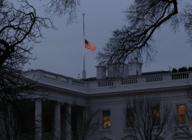 As ordered by President Obama, the American flag flies at half-staff at dawn over the White House in observance of the victims of Saturday's shooting in Tucson.
