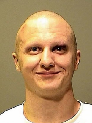 Mugshot photo released by the Pima County Sheriff's Office of shooting suspect Jared Loughner.