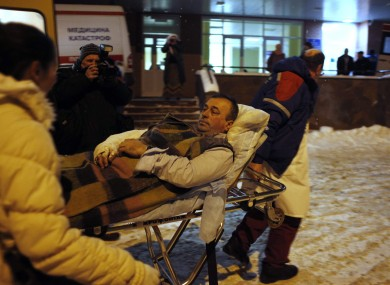 A blast victim is brought by rescuers to a hospital from Domodedovo airport.