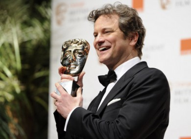 Colin Firth poses with the award for Best Actor