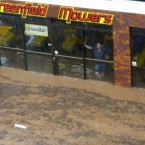 A man watches as water flows past in Toowoomba, Australia, during a flash flood 10 January, 2011. (AP Photo/ABC)