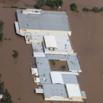 An entire shopping mall lies submerged outside Ipswich, west of Brisbane, Australia on 12 January, 2011. (AP Photo)