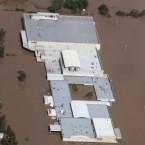 An entire shopping mall lies submerged outside Ipswich, west of Brisbane, Australia on 12 January, 2011. (AP Photo)