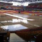 Floodwater turns Brisbane's Suncorp Stadium into a giant swimming pool on 12 January, 2011. (AP Photo)