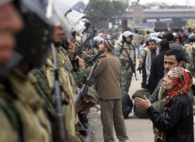 Egytian soldiers line up to form a guard around anti-Mubarak protesters in Cairo, Egypt, on 5 February, 2011.