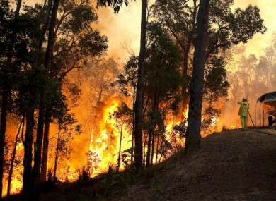This photo from the Fire and Emergency Services Authority of Western Australia shows a bushfire raging near a home in Roleystone, Perth.