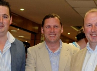 Barry Cowen (centre) pictured at the Paddy Power.com derby