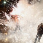 People run away from fireworks exploding around them in Mexico City to celebrate the day of Saint Santiago. (AP Photo/Eduardo Verdugo)