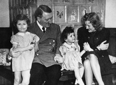 An intimate family picture of German Chancellor Adolf Hitler, Eva Braun and two little girls, shown Nov. 17, 1945.  There have been various reports that the couple had at least one child.