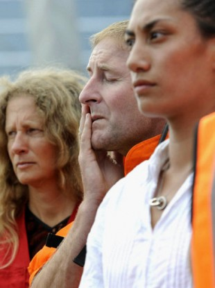 A man wipes away tears as people offer a moment of silent prayer in Christchurch, New Zealand, on March 1, 2011, a week after an earthquake devastated the area.