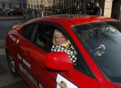 New Fine Gael TD Mary Mitchell O'Connor leaves in her car after driving across the plinth in Leinster House this afternoon.
