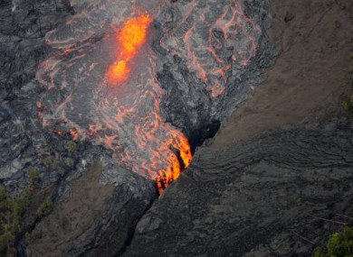 Lava flows from the Pu'u O'p crater on Kilauea yesterday in Hawaii.